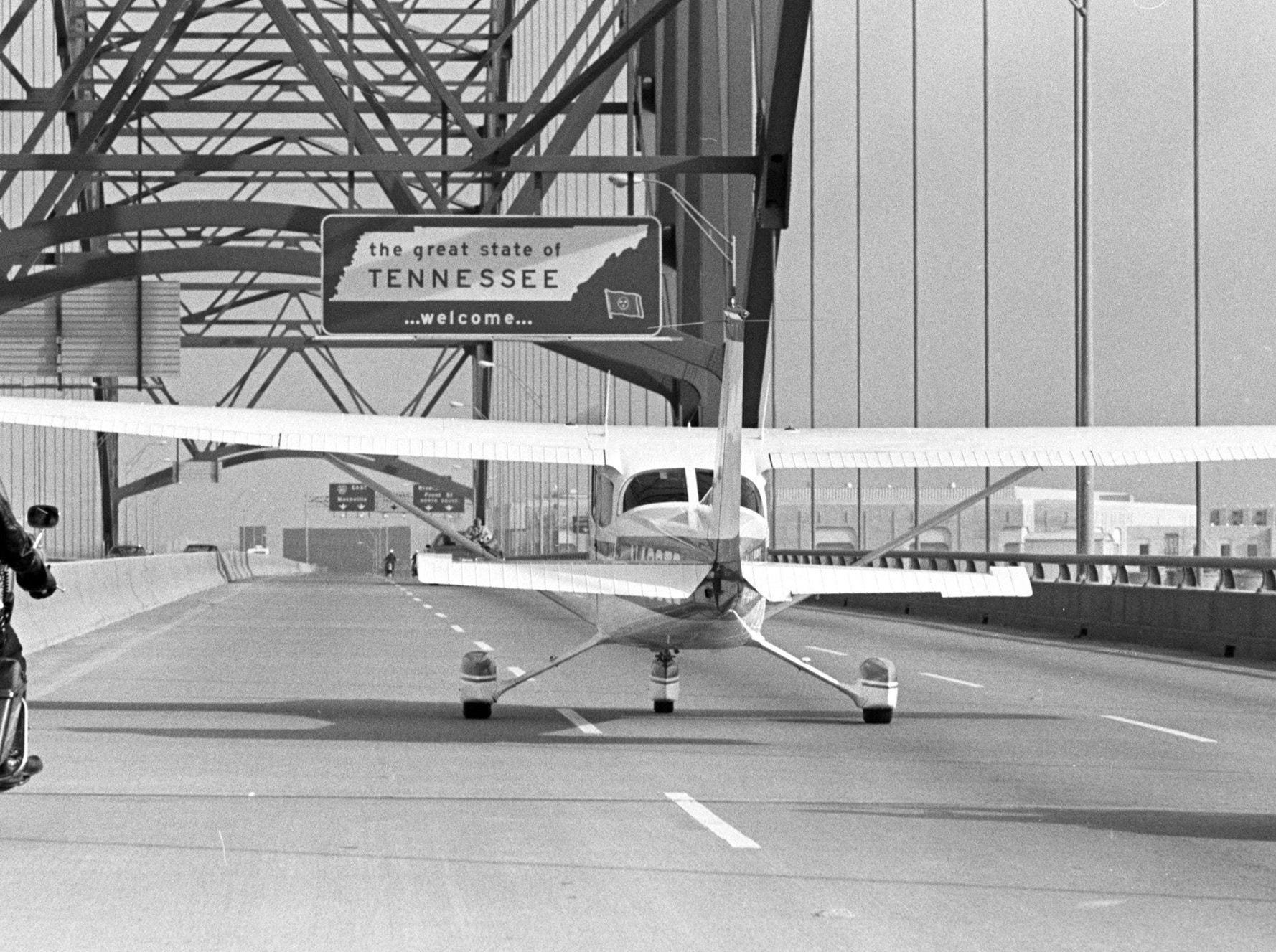This Cessna aircraft made a temporary landing strip out of an approach to the Hernando DeSoto Bridge on its way to the Mid-American Outdoor Recreation Show in the Cook Convention Center on 22 Jan 1975. The plane, piloted by Bill Rachels Jr., landed on the bridge because it was the easiest way to get it to the convention building. The bridge and the approaches to both ends were closed by police for the landing.