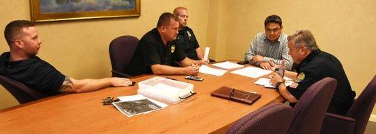 Police Chief Al Schettino, right, and interim City Manager Gil Polanco talk with negotiators Officer John Derrick, from left, PBA chapter president Matt Sellers, and Officer Paul Ashby. City officials and police union representatives held their second meeting Tuesday morning at City Hall, trying to come to agreement on a contract for the police rank and file.