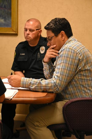 Interim City Manager Gil Polanco talk with negotiators including MIPD Officer Paul Ashby. City officials and police union representatives held their second meeting Tuesday morning at City Hall, trying to come to agreement on a contract for the police rank and file.