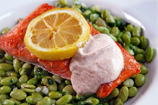 Lemon Salmon with Edamame and Yogurt Sauce is a quintessential dish for the Mediterranean diet.