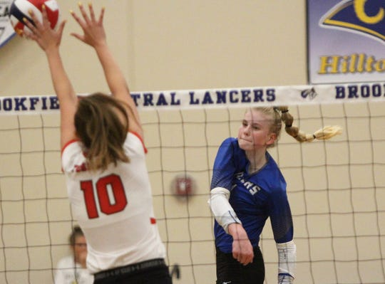 Brookfield Central outside hitter Mckenna Wucherer swings to record a kill against Wauwatosa East on August 28.