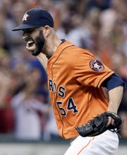 Houston Astros starting pitcher Mike Fiers screams and pumps his fist after throwing eight hitless innings against the Los Angeles Dodgers in a baseball game Friday, Aug. 21, 2015, in Houston.