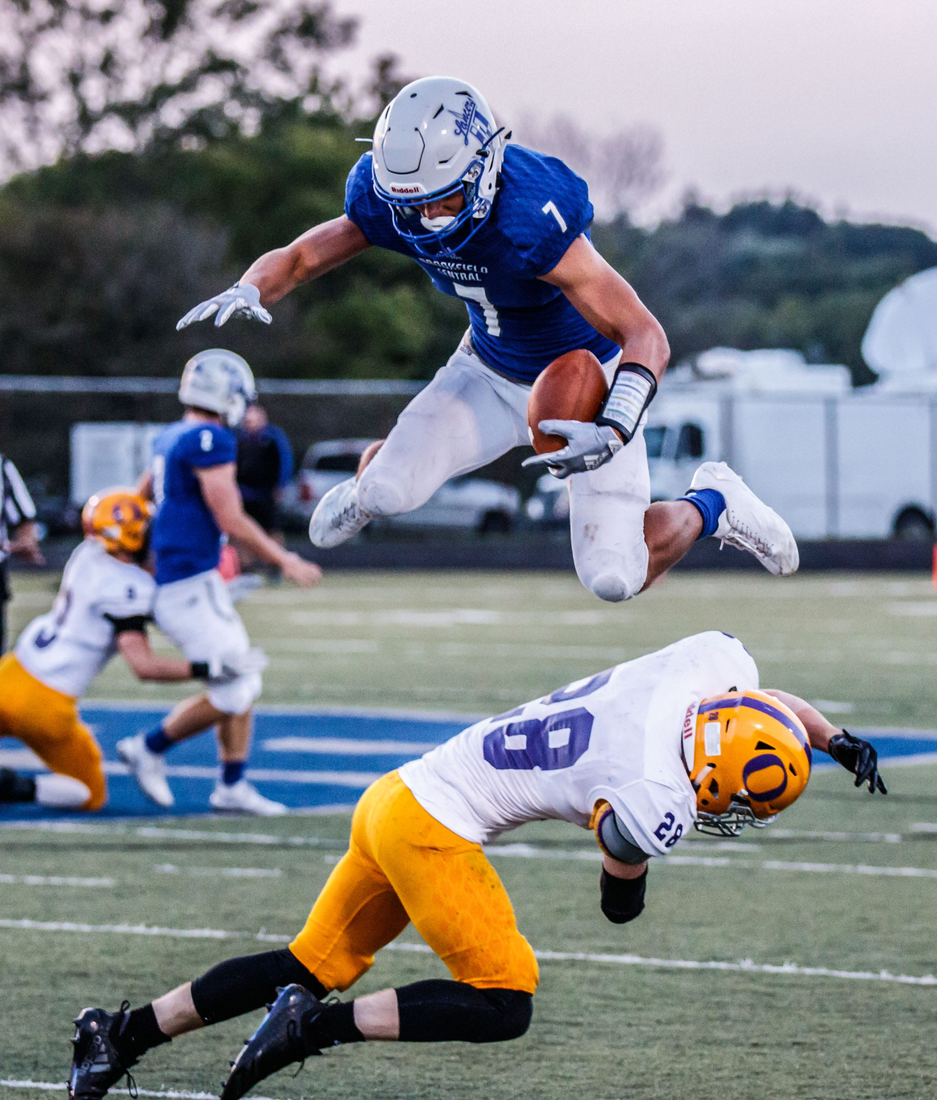 Brookfield Central wide receiver Julian Banda hurdles Oconomowoc's Conor Ellis during a game at Brookfield on Aug. 23.