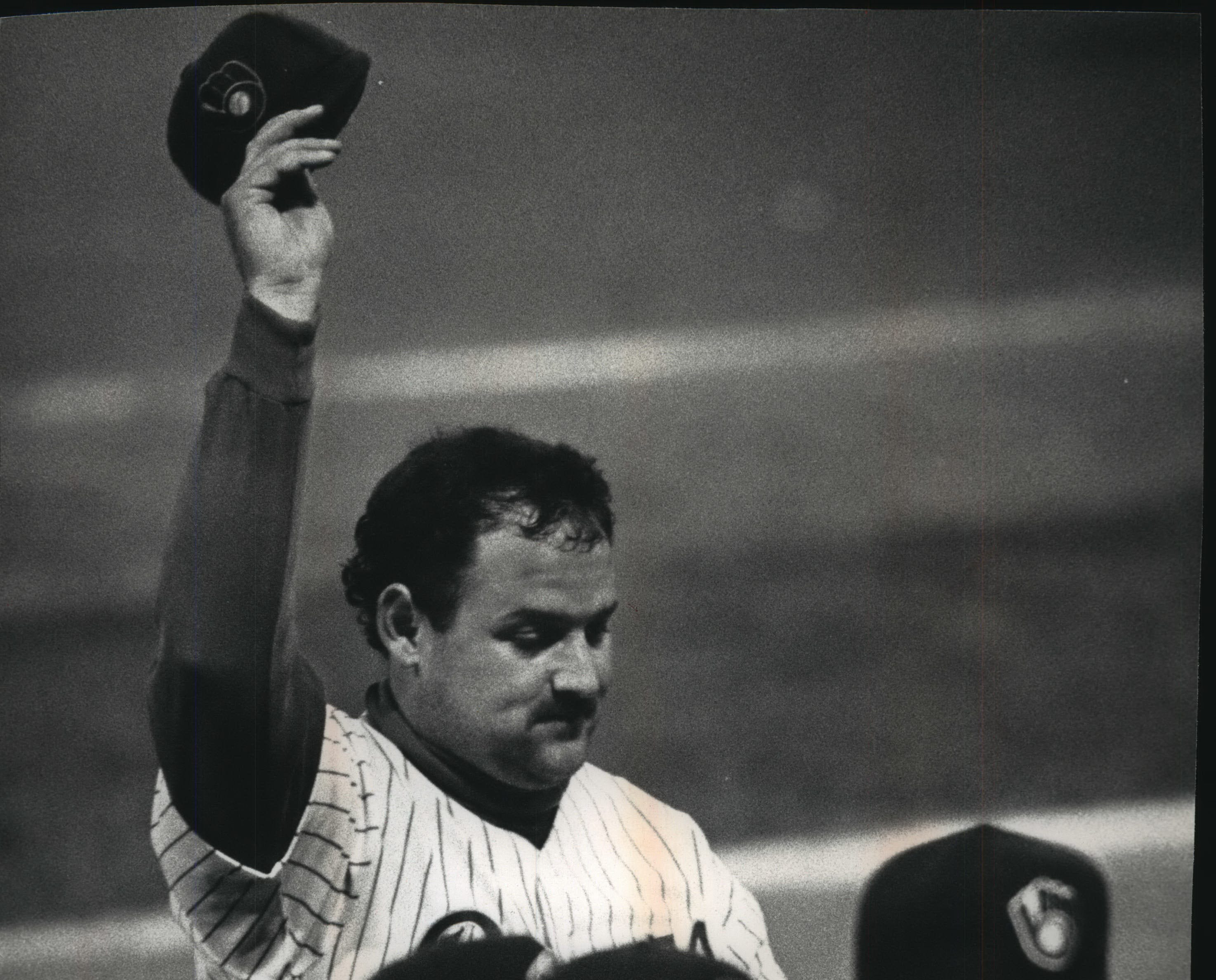 Pitcher Chris Bosio tips his cap after throwing a shutout in 1992.