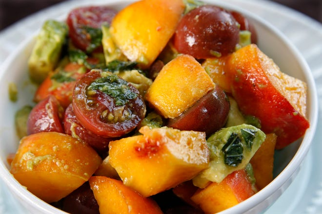 Tomatoes with avocado, peaches and mint showcase a favorite late-summer fruit. For best flavor, use heirloom varieties.