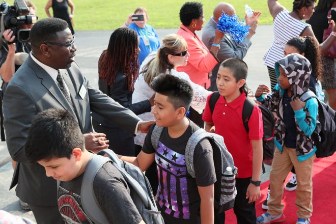 Keith Posley, then-interim superintendent of Milwaukee Public Schools, greets students at Audubon Technology and Communications Center on the first day of school in August.