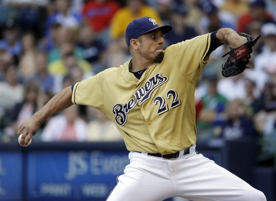 Milwaukee Brewers starting pitcher Matt Garza throws during the fifth inning of a baseball game against the Philadelphia Phillies on Thursday, July 10, 2014, in Milwaukee.