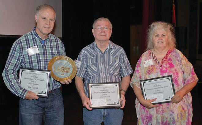 Johnnie Hensley of Mountain Home placed second in Senior Division of the the Arkansas State Fiddle Championship held Aug. 11 at the Ozark Folk Center State Park in Mountain View. Pictured are: (from left) Tim Trawick of Conway, first place; Hensley; and Suzi Vause, Ellsinore, Mo., third place. The contest is produced by the Ozark Folk Center State Park and sponsored by The Committee of 100 and Old Time Ozark Traditions, Inc.