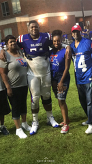 O'Shea Dugas after a game with his mother, Eva Walker, left, girlfriend Taylor Simone and father, Shawn Dugas.