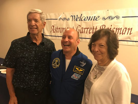 Parsippany native and former NASA Mission Specialist Garrett Reisman, center, meets with his former Parsippany high School wrestling coach, Gary Vittorio, and his wife of 62 years, Joan, after a STEM education event at the Parsippany Library Main Branch. August 31, 2018
