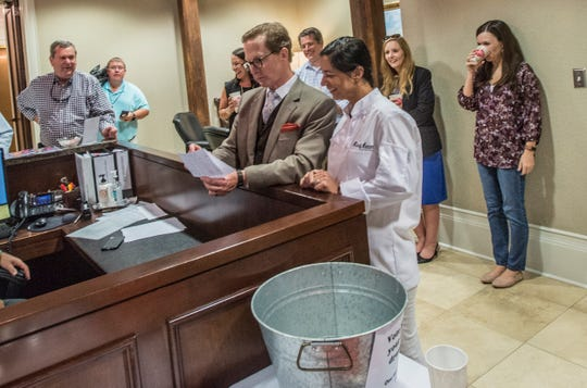 Attorney Will Hill Tankersley and contest judge chef Missy Mercer announce the winners of the public and judges top chicken picks. Martin's chicken was the top pick for the judges. The people's choice vote went to Publix. The Montgomery law office of Balch & Bingham hosted Drumstickpalooza on Thursday, Aug. 30, 2018, a competition between local restaurants to determined who makes the best drumstick in the River Region.