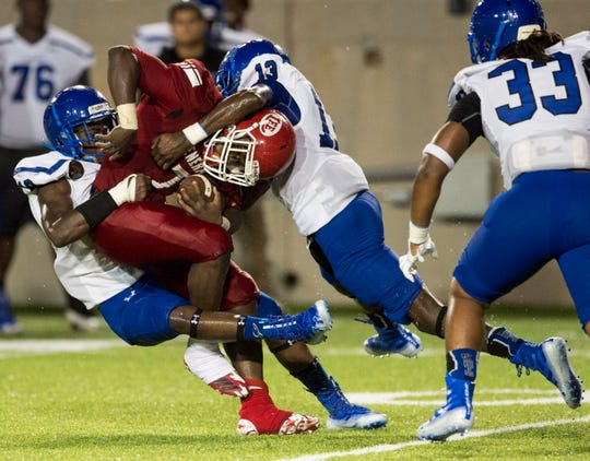 Lee's Tedarrian Murray (7) is taken down by multiple Lanier defenders at the Cramton Bowl in Montgomery, Ala., on Thursday, Aug. 30, 2018. Lee leads Lanier 7-0 at halftime.