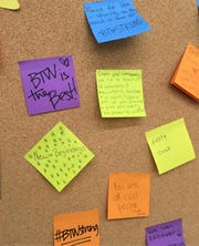 "Sticky notes on a ""Share Some Love"" sign in a hallway at the Hayneville Road School where BTW students now attend."