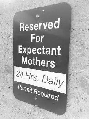 A sign identifies an expectant mothers parking space in the student center parking garage at Ball State University.