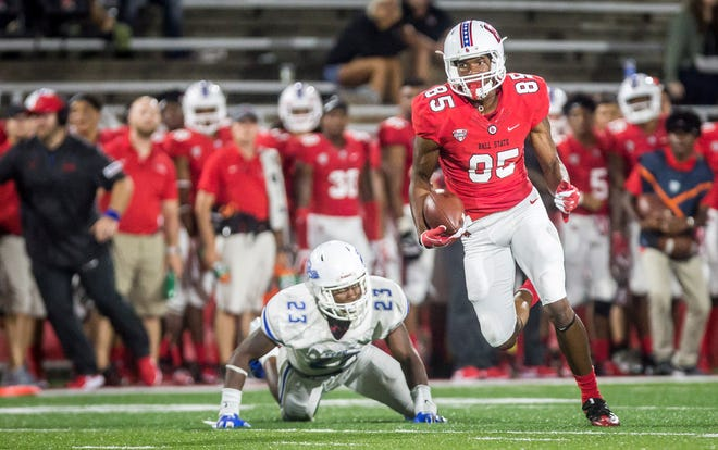 Ball State's Yo'Heinz Tyler catches a pass from Riley Neal and runs for a touchdown against Central Connecticut State on Thursday night in Scheumann Stadium during Ball State's home opener.