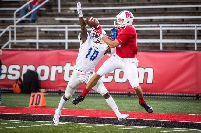 Ball State's Riley Miller goes up for a ball against Central Connecticut State on Thursday night in Scheumann Stadium during Ball State's home opener.