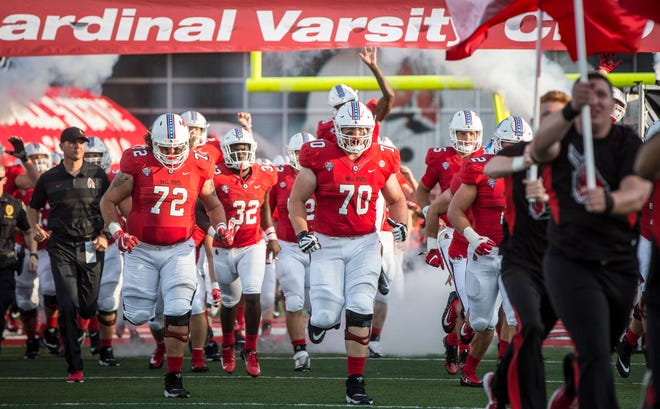Ball State lineman Alex Joss (70) leads the team onto the field for the season opener against Central Connecticut State on Aug. 30 at Scheumann Stadium.