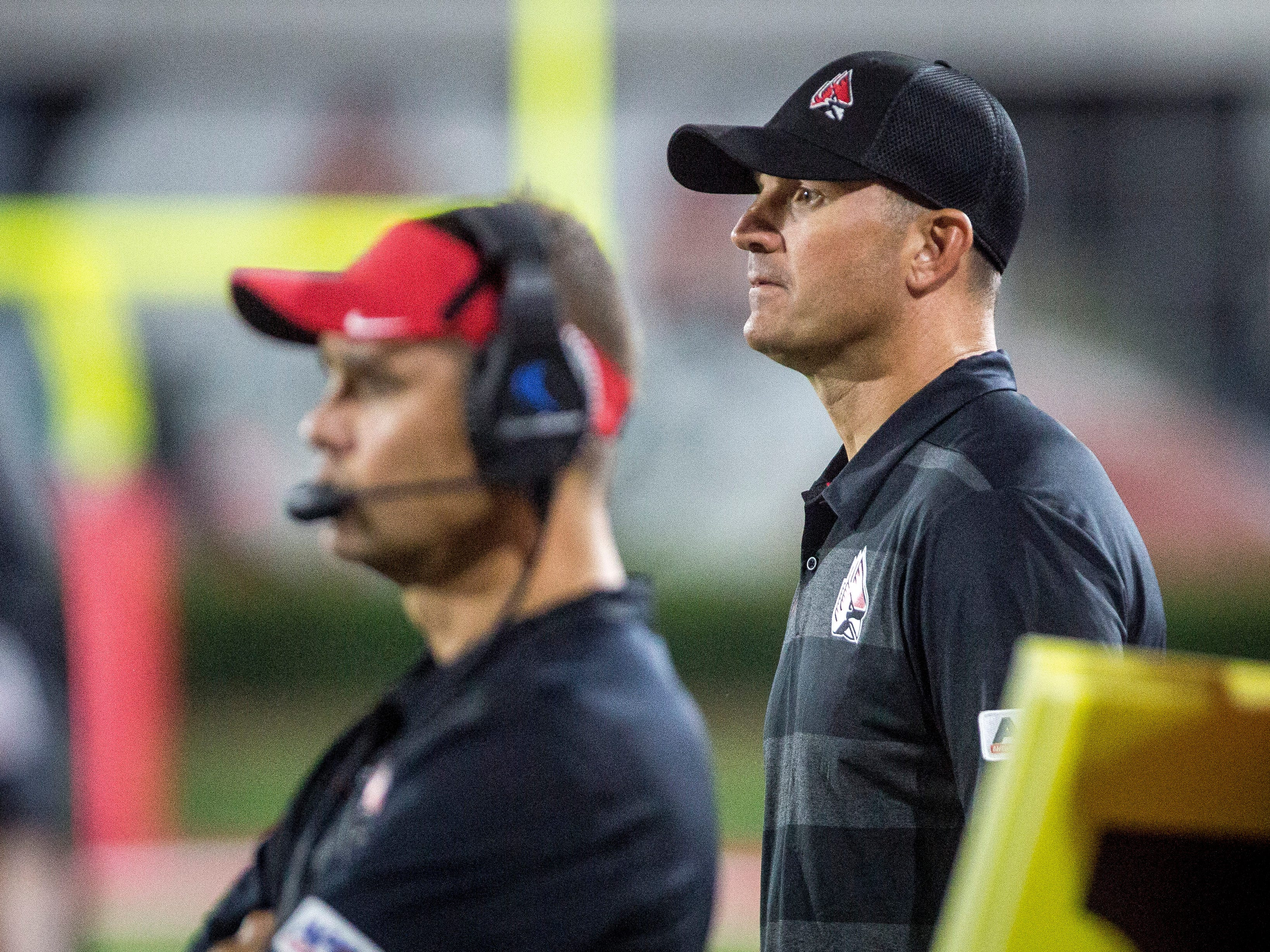 Ball State's Mike Neu, right, coaches against Central Connecticut State on Thursday night in Scheumann Stadium during Ball State's home opener.