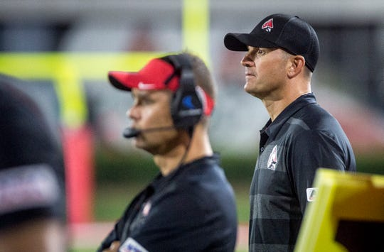 Ball State's Mike Neu, right, coaches against Central Connecticut State in Scheumann Stadium during Ball State's home opener on Aug. 30, 2018.