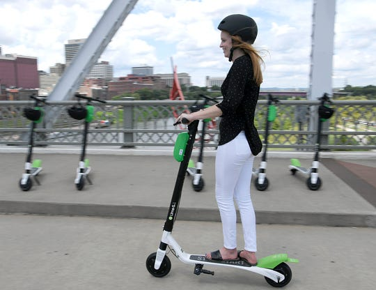 Emma Green with Lime helped kicked off the company's Nashville electric scooter launch on the John Seigenthaler Pedestrian Bridge on Aug. 31, 2018.