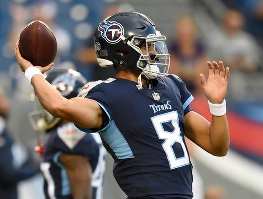 Tennessee Titans quarterback Marcus Mariota (8) passes during warmups before the preseason game against the Vikings at Nissan Stadium Thursday, Aug. 30, 2018, in Nashville, Tenn.