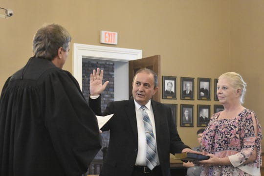 Cheatham County Mayor Kerry McCarver is sworn in during a ceremony at the Cheatham County Courthouse on Thursday, Aug. 30.