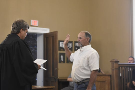 Cheatham County Commissioner Walter Weakley is sworn in during a ceremony at the Cheatham County Courthouse on Thursday, Aug. 30.