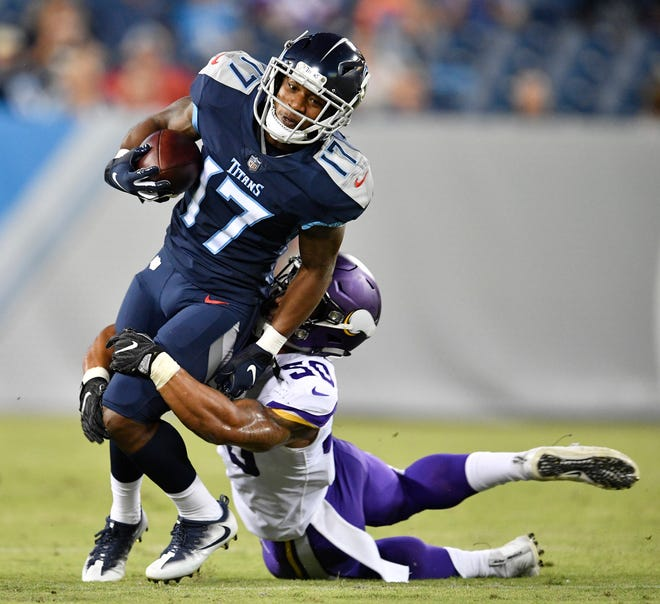Tennessee Titans wide receiver Cameron Batson (17) is stopped by Minnesota Vikings linebacker Eric Wilson (50) in the first half of a preseason game at Nissan Stadium Thursday, Aug. 30, 2018, in Nashville, Tenn.