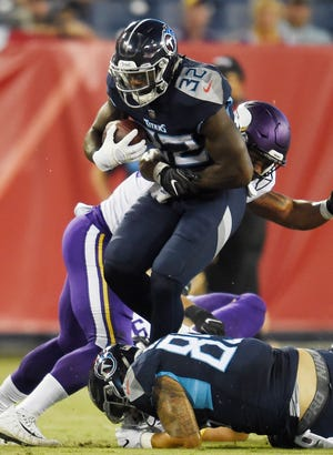 Tennessee Titans running back David Fluellen (32) gains some yards during the first quarter of a preseason game against the Vikings at Nissan Stadium Thursday, Aug. 30, 2018, in Nashville, Tenn.