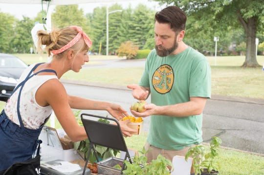 Jenni Adams chats with Chris Wilhelm about produce from The Madison Farm during the Goodlettsville Farmers Market on the lawn of the Goodlettsville Visitor's Center at Historic Mansker's Station on Thursday, Aug. 30.