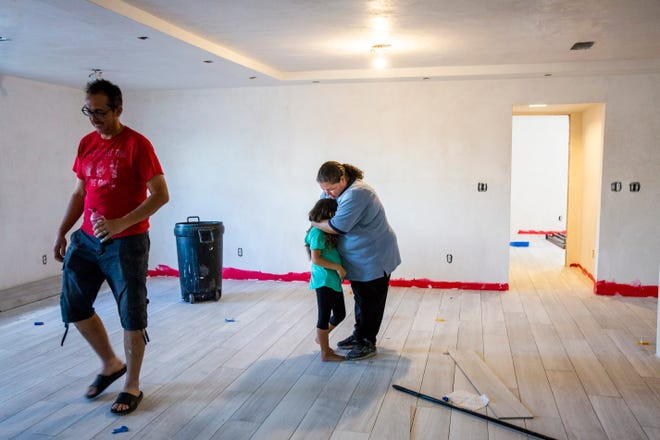 Shannon Mitchell hugs her daughter Aria, 7, inside their home, which is still undergoing renovations from Hurricane Irma, in Everglades City on Thursday, Aug. 16, 2018. After almost a year of temporary living situations, including a nearby one-bedroom apartment, a fifth wheel camper and a newly converted shed on their property, the Mitchell family hopes to move into their fully renovated house by mid-September.