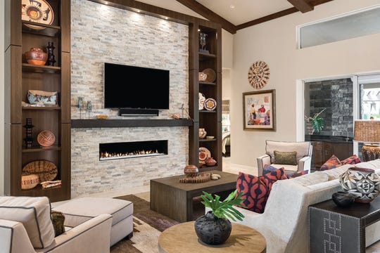 After: A linear fireplace with custom wood cabinetry replaced the entertainment center.