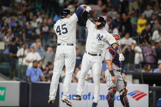 New York Yankees first baseman Luke Voit (45) congratulates shortstop Gleyber Torres (25) on his two run home run in the fourth inning against the Detroit Tigers at Yankee Stadium.