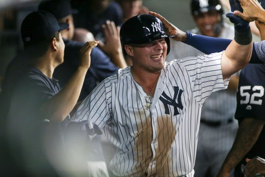 New York Yankees first baseman Luke Voit (45) is greeted by his teammates after hitting a two run home run in the seventh inning against the Detroit Tigers at Yankee Stadium.