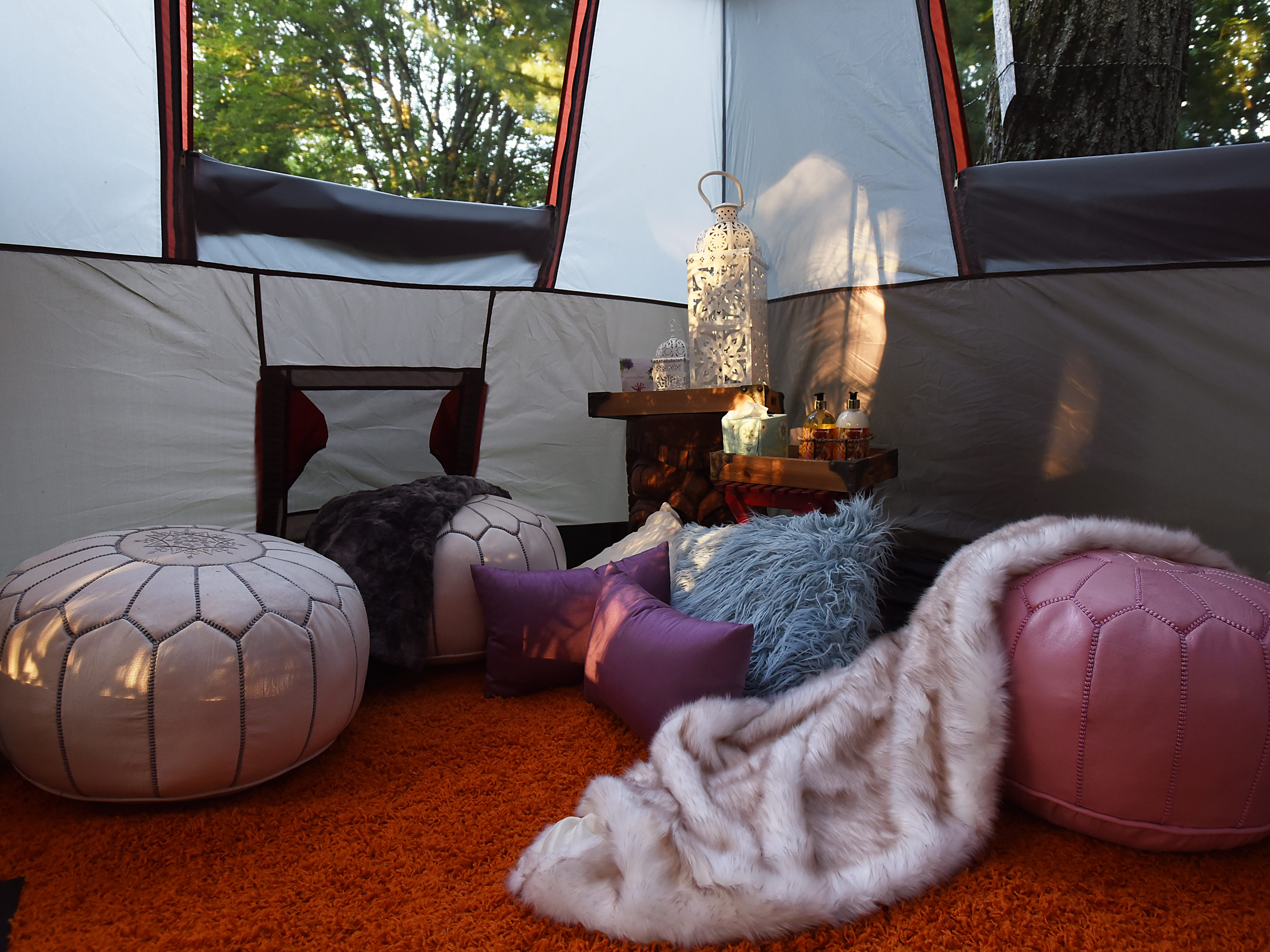 Melissa Ricapito and Mark Pyrka decide to rent out a tent in their backyard on Airbnb as a joke, much to their surprise it's been a hit. The tent rental allows access to all the backyard amenities the West Milford home has to offer. The sitting area of the three room tent is decorated with ottomans, throws, pillows and other accessories. Shown on Thursday August 30, 2018.