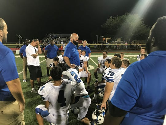 St. Mary coach Mike Coyne speaks to his football team after a loss at NJIC Patriot rival Emerson on Thursday, Aug. 30, 2018.