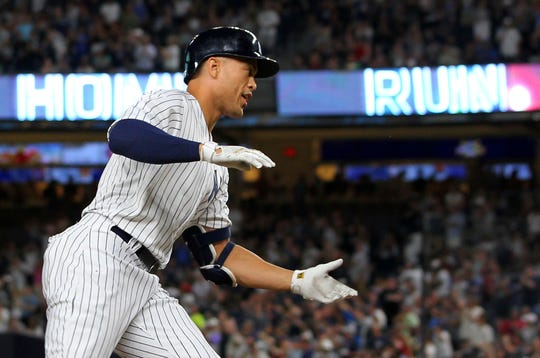 New York Yankees' Giancarlo Stanton rounds third base after he hit a two-run home run during the third inning against the Detroit Tigers in a baseball game Thursday, Aug. 30, 2018, at Yankee Stadium in New York. It was Stanton's 300th career home run.