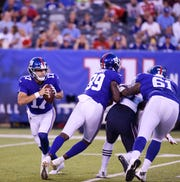 Giants vs. Patriots preseason game at MetLife Stadium in East Rutherford on Thursday, August 30, 2018. G #17 Kyle Lauletta looks to pass in the first quarter.