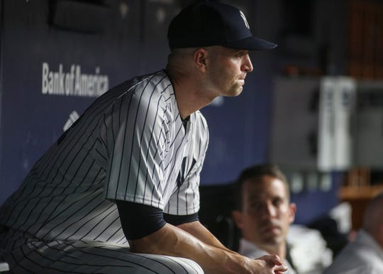 New York Yankees pitcher J.A. Happ (34) sits in the dugout after getting taken out in the fifth inning against the Detroit Tigers at Yankee Stadium.