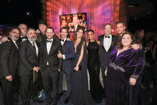 "The cast and crew of the popular NBC series ""This Is Us"" surrounds Fogelman (fifth from left) at the 2017 E! Entertainment Golden Globes after party."
