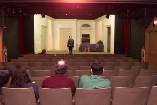 """Call-back audition for the play """"""""Thumbs!"""""""" at The Little Firehouse Theater in 2001. Annette Jarred waits on stage while from left, Rupert Holmes and Larry Landsman discuss her performance"""