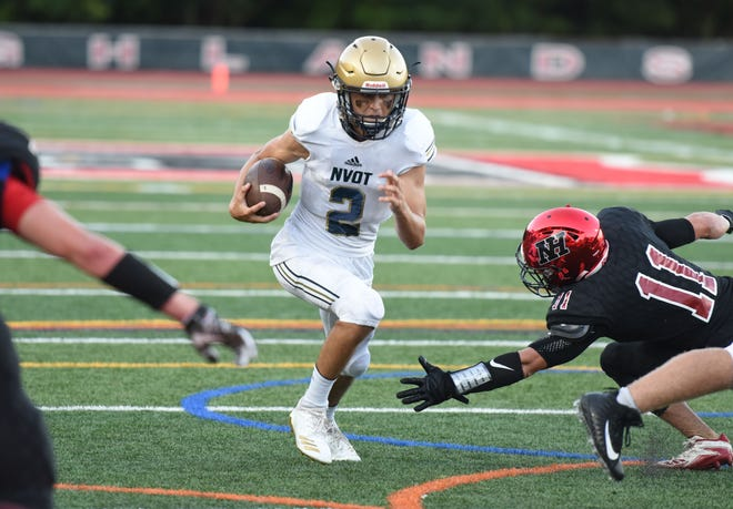 NV/Old Tappan's Drew Dippolito (2) runs through Northern Highlands defenders during their game on the opening day of high school football Thursday, Aug. 30, 2018.