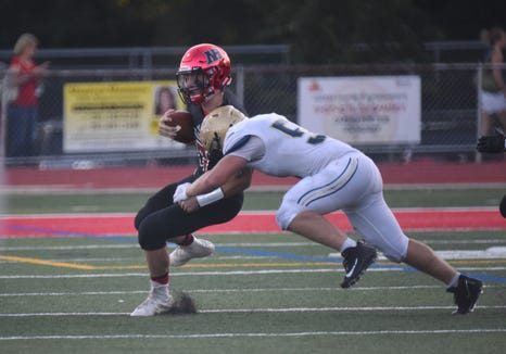 Northern Highlands' Jack Stephen (17)  is tackled by NV/Old Tappan's Jackson Downey(51) on Thursday, Aug. 30, 2018, as high school football kicked off in New Jersey.