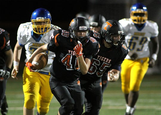 Tenafly's Jeremy Abramowitz rushing in a game last year with blocking help from Isaac Berman.