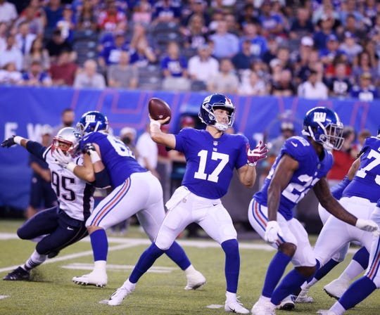 Giants vs. Patriots preseason game at MetLife Stadium in East Rutherford on Thursday, August 30, 2018. G #17 Kyle Lauletta throws a pass in the first quarter.