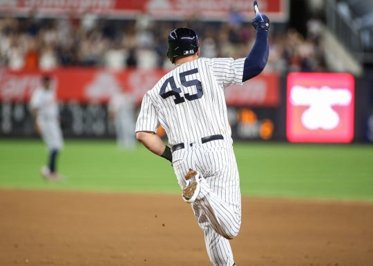 New York Yankees first baseman Luke Voit (45) hits a two run home run in the seventh inning against the Detroit Tigers at Yankee Stadium.