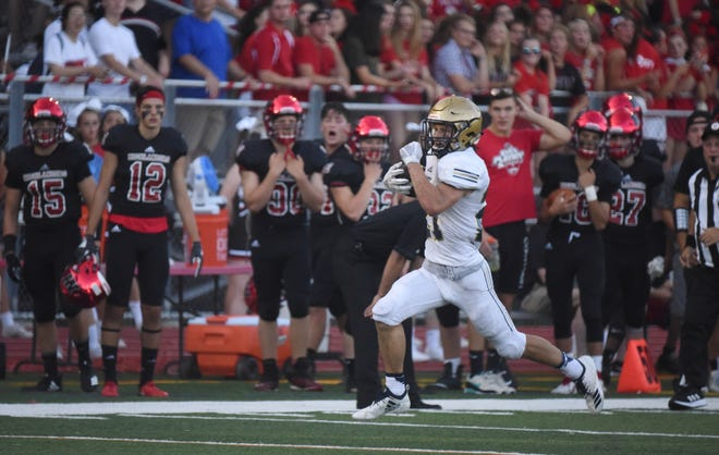 NV/Old Tappan's Johnny Lohrer in the open field. Lohrer scores a pair of touchdowns as OT downs Northern Highlands, 35-14, in the season opener for football, Thursday, Aug. 30, 2018.