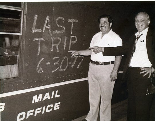 Oakland postmaster Frank Leone, left, pointing out the last mail delivery via freight train from New York to Washington, D.C., in 1977