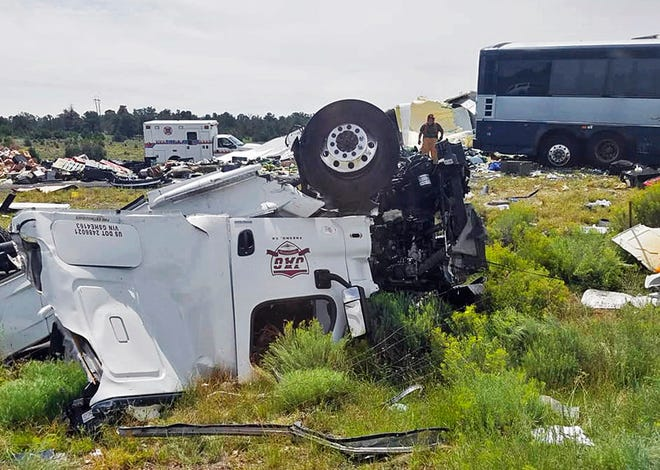 This photo provided by Chris Jones shows first responders working the scene of a collision between a Greyhound passenger bus and a semi-truck on Interstate 40 near the town of Thoreau, N.M., near the Arizona border, Thursday, Aug. 30, 2018. Multiple people were killed and others were seriously injured.