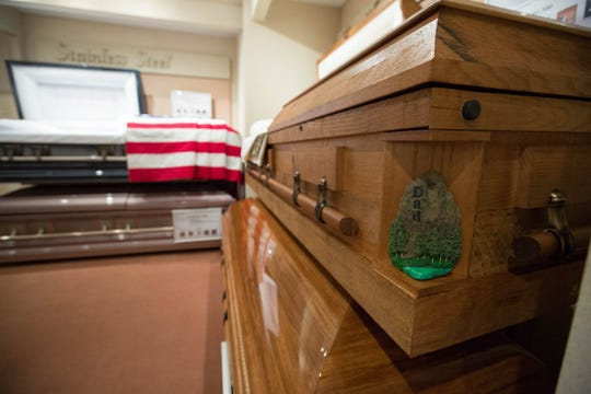 A display casket stands in a showroom at Getz Funeral Home in Las Cruces on Friday, Aug. 31, 2018.